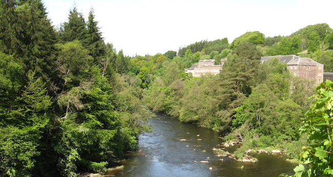 New Lanark with river in foreground, courtesy of James Denham on Flickr Creative Commons