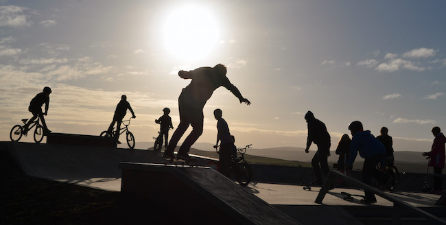 Silhouette of people using skatepark funded by Shetland LEADER