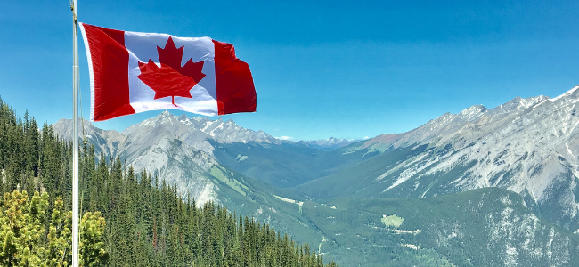 Canadian flag against mountain backdrop