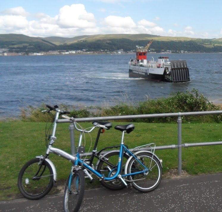 Two bikes with ferry in the background