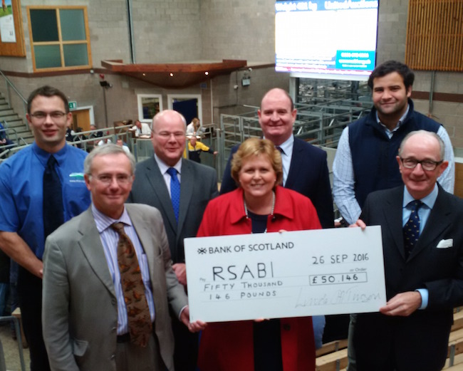 Group photo with giant cheque