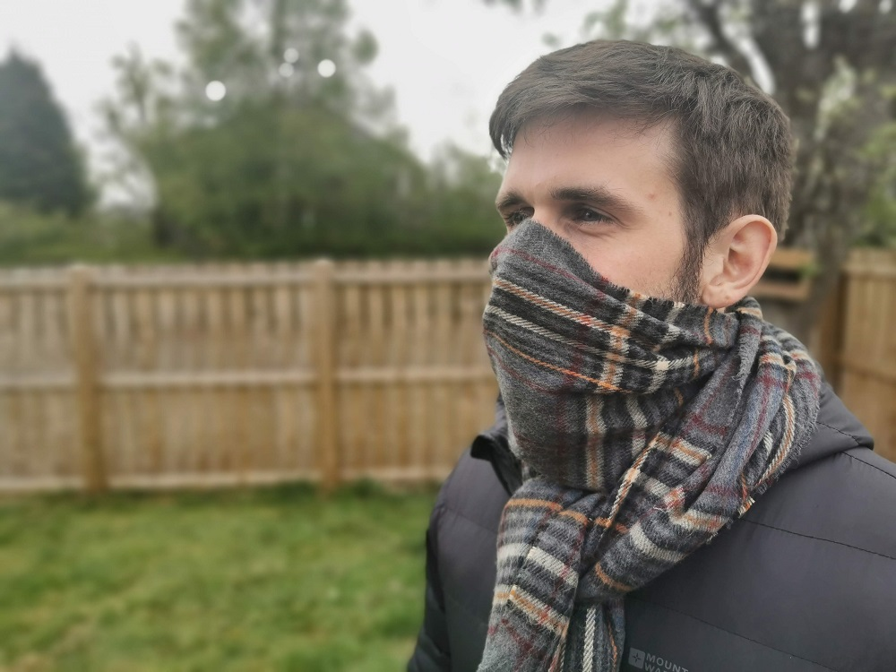 man wearing scarf over face