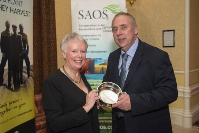 Alistair Ewan receiving his award from Katy Rainy Brown