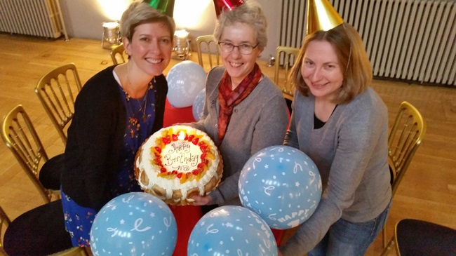 Anne Rowe, Sandra Hogg and Rhonda Mclean of Funding Scotland celebrate with a birthday cake