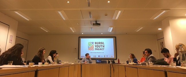 Brussels event with Rural Youth Project logo showing on screen