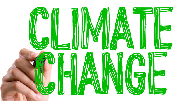 Climate Change being written in green text