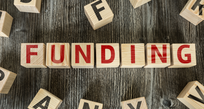 Funding written on blocks