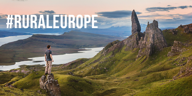 Man standing on hill in Skye, with #RuralEurope text, photo courtesy of Joshua Earle on Unsplash