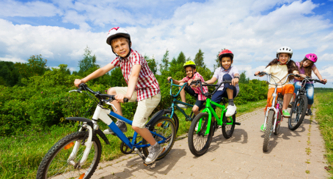Children riding bikes on cycle path