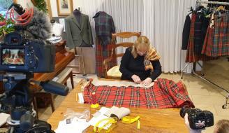 A women working in perthshire based tartan making business
