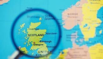 Magnifying glass over map of Scotland