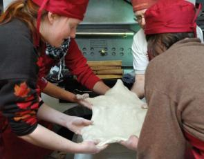Group of bakers stretching dough