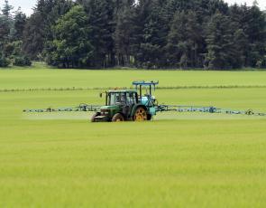 Crop sprayer in field
