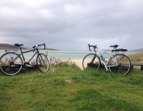 Two bikes parked by beach