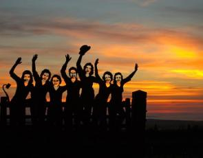 Women's land army memorial at sunset