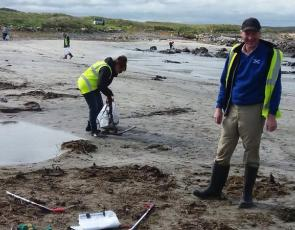 Volunteers litter picking on beach