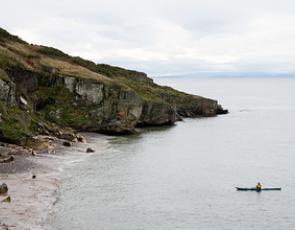Kayak at sea off cliffs at Lossiemouth