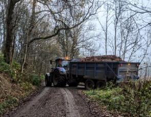 Tractor and trailer on farm track
