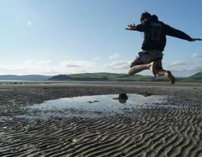 Boy jumping on beach
