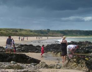 Families enjoying a visit to the beach