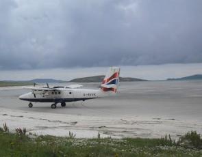 Wee plane landing on Barra beach runway