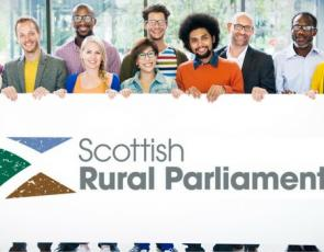 Group of people 'holding' Scottish Rural Parliament logo