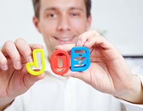 Person holding up 'Job' letters