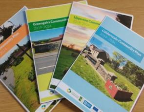 Copies of four community action plan booklets