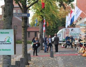 Street scene of Venhorst with European Rural Parliament sign