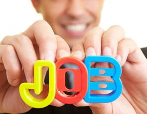 Person holding letters spelling 'job'