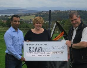 SAOS chairman and NFUS Treasurer, George Lawrie with Linda Tinson, Director of Rural business for event sponsor Ledingham Chalmers, solicitors, presenting a cheque to Harry Seran, RSABI finance manager.