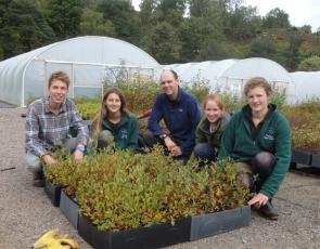 Group of people at plant nursery
