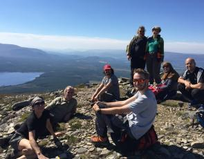 Volunteers taking a break at the top of the Meall aBhuachaille in the Cairngorms
