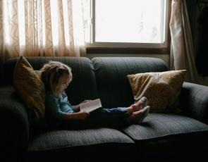 Young Girl Reading by Josh Applegate