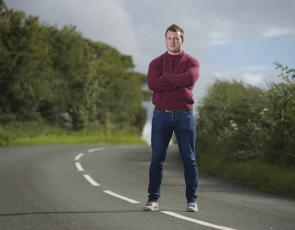 Man standing in road