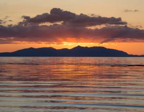 Sunset over the Isle of Arran viewed from Ayr beach. Credit: Visit Scotland/Kenny Lam