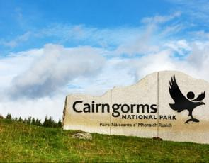 Cairngorms National Park sign on hillside