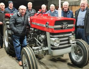 Restored tractor with restorers L to R - Michael Watson, Jim Purdie, John McNae, Andrew Craig, David Harvey, Wallace Lapsley, Lex Craig & Russell McNab