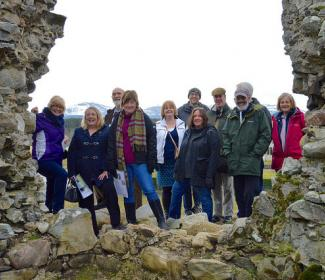 Group photo of people on Project Visit at Castle Roy