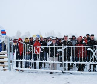 Group photo of people in the snow at the opening of Kingussie Shinty Club pitch