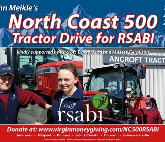 Man and woman next to tractor advertising North Coast 500 Tractor Ride