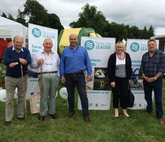 Members of the public and Local Action Group members standing next to Tyne Esk LEADER banners at the Dalkeith show