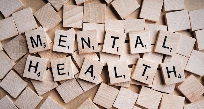 Mental health written on tiles