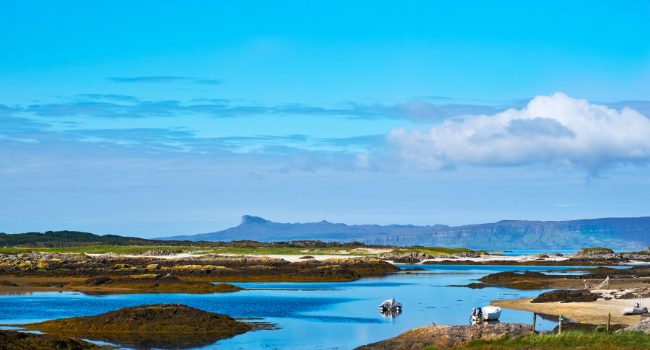 Coastal landscape, with Isle of Eigg in distance