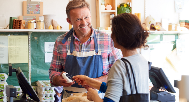 man serving customer in shop