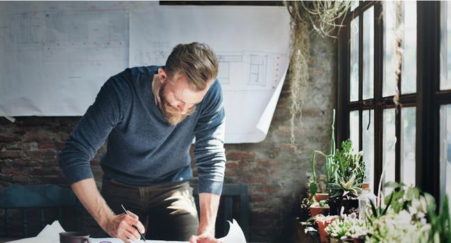Man looking at architectural drawings