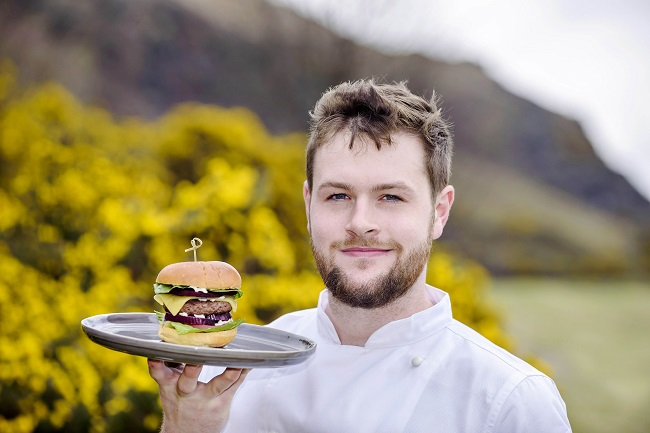 Chef Ambassador Fraser Cameron holding the Galloway Gourmet Burger