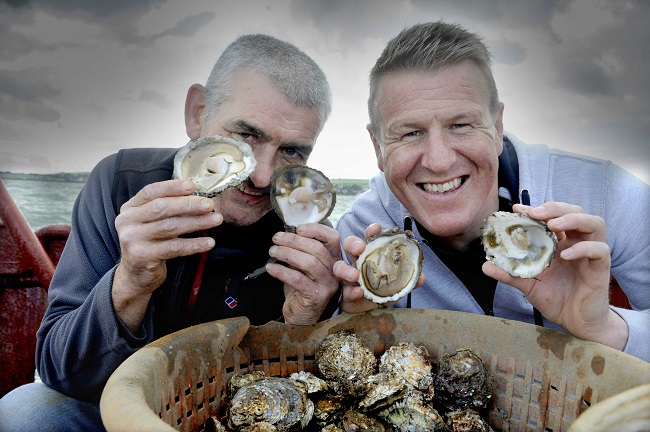 "Pictured aboard the ""Vital Spark"", a Stranraer based fishing vessel gathering the first oyster haul of the season are Allan Jenkins (left, project manager for Stranraer Development Trust, the community organisation that runs the oyster festival) and Vital Spark captain and oyster fisherman Rab Lamont."