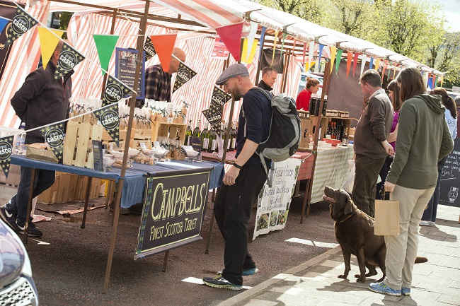 Moffat Farmers' Market - customer at market stall