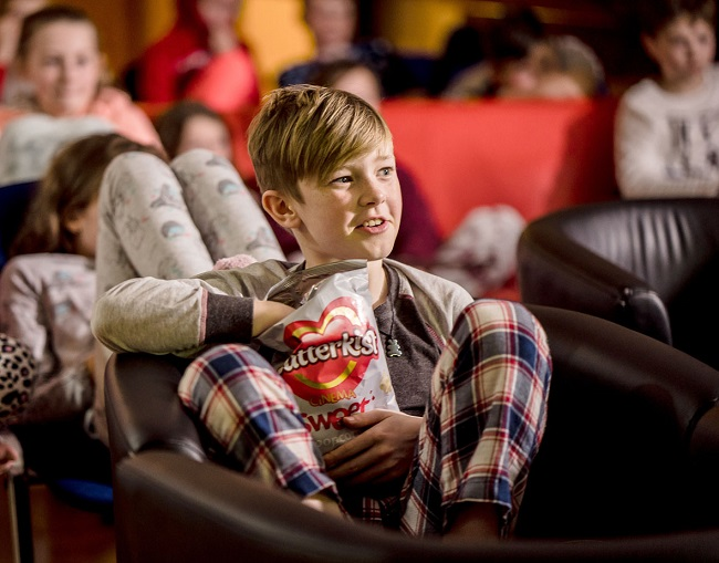 Group of young people enjoying movie night at Inverness Youth Hostel